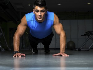 Healthy young guy doing push up exercise